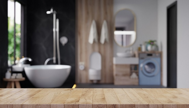 Wood table top on blur bathroom,Empty tabletop for product display with blurred bathroom.